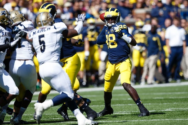 Sep 14, 2013; Ann Arbor, MI, USA; Michigan Wolverines quarterback Devin Gardner (98) passes the ball against the Akron Zips at Michigan Stadium. Mandatory Credit: Rick Osentoski-USA TODAY Sports