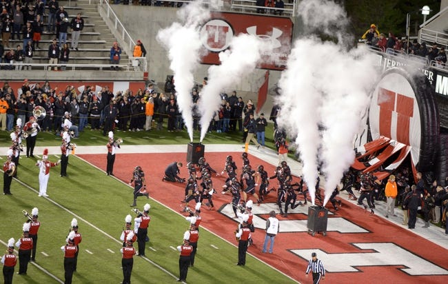 Oct 3, 2013; Salt Lake City, UT, USA; Utah Utes players run onto the field through a procession of smoke and the marching band before the game against the UCLA Bruins at Rice-Eccles Stadium. UCLA defeated Utah 34-27. Mandatory Credit: Kirby Lee-USA TODAY Sports