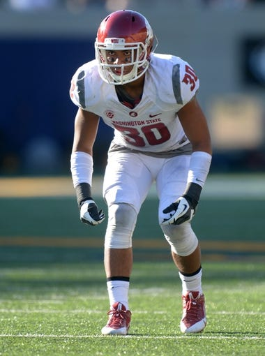 Oct 5, 2013; Berkeley, CA, USA; Washington State Cougars safety Taylor Taliulu (30) during the game against the California Golden Bears at Memorial Stadium. Washington State defeated California 44-22. Mandatory Credit: Kirby Lee-USA TODAY Sports