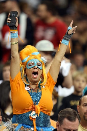 Sep 30, 2013; New Orleans, LA, USA; Miami Dolphins fan Jen Schultz of Royal Palm Beach, Fla., cheers during the first quarter against the New Orleans Saints at the Mercedes-Benz Superdome. Mandatory Credit: Chuck Cook-USA TODAY Sports