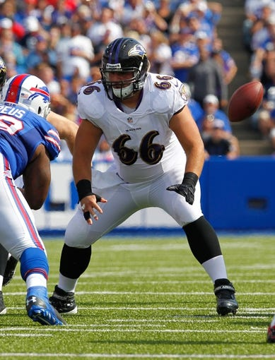 Sep 29, 2013; Orchard Park, NY, USA; Baltimore Ravens center Gino Gradkowski (66) against the Buffalo Bills at Ralph Wilson Stadium. Mandatory Credit: Timothy T. Ludwig-USA TODAY Sports
