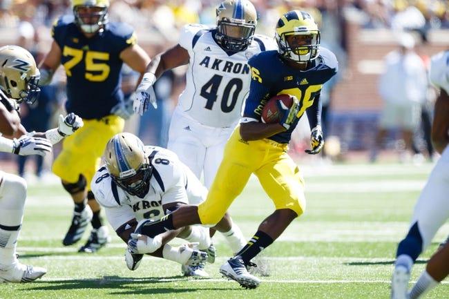 Sep 14, 2013; Ann Arbor, MI, USA; Michigan Wolverines tight end Jake Butt (88) runs the ball against the Akron Zips at Michigan Stadium. Mandatory Credit: Rick Osentoski-USA TODAY Sports