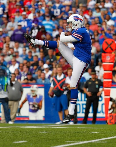 Sep 29, 2013; Orchard Park, NY, USA; Buffalo Bills punter Shawn Powell (6) punts the ball against the Baltimore Ravens at Ralph Wilson Stadium. Bills beat Ravens 23 to 20.  Mandatory Credit: Timothy T. Ludwig-USA TODAY Sports