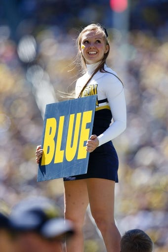 Sep 14, 2013; Ann Arbor, MI, USA; Michigan Wolverines cheerleader during the game against the Akron Zips at Michigan Stadium. Mandatory Credit: Rick Osentoski-USA TODAY Sports
