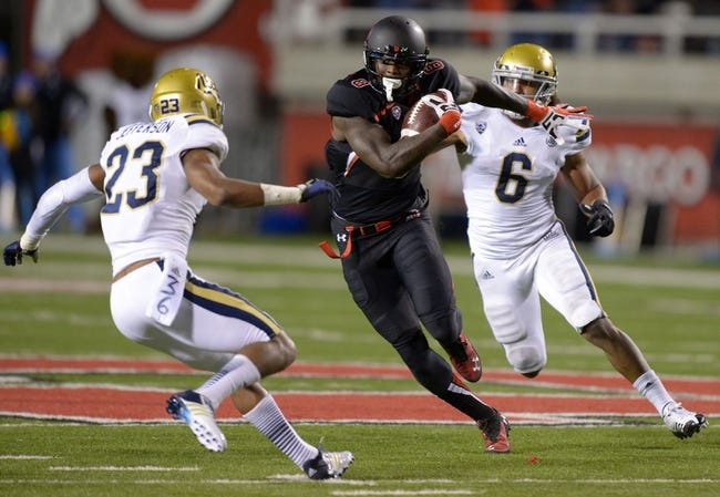 Oct 3, 2013; Salt Lake City, UT, USA;  Utah Utes receiver Anthony Denham (8) is pursued by UCLA Bruins linebacker Eric Kendricks (6) and defensive back Anthony Jefferson (23) n a 30-yard reception in the second quarter at Rice-Eccles Stadium. Mandatory Credit: Kirby Lee-USA TODAY Sports