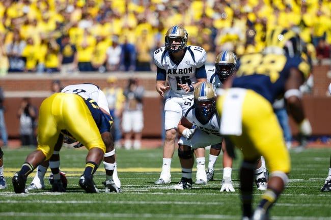 Sep 14, 2013; Ann Arbor, MI, USA; Akron Zips quarterback Kyle Pohl (16) gets set to run a play against the Michigan Wolverines at Michigan Stadium. Mandatory Credit: Rick Osentoski-USA TODAY Sports