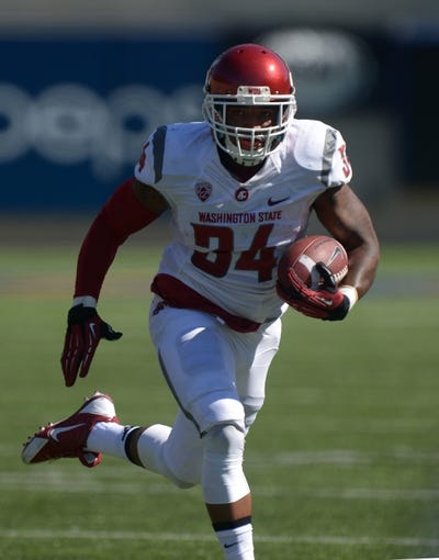Oct 5, 2013; Berkeley, CA, USA; Washington State Cougars running back Teondray Caldwell (34) carries the ball against the California Golden Bears at Memorial Stadium. Washington State defeated California 44-22. Mandatory Credit: Kirby Lee-USA TODAY Sports