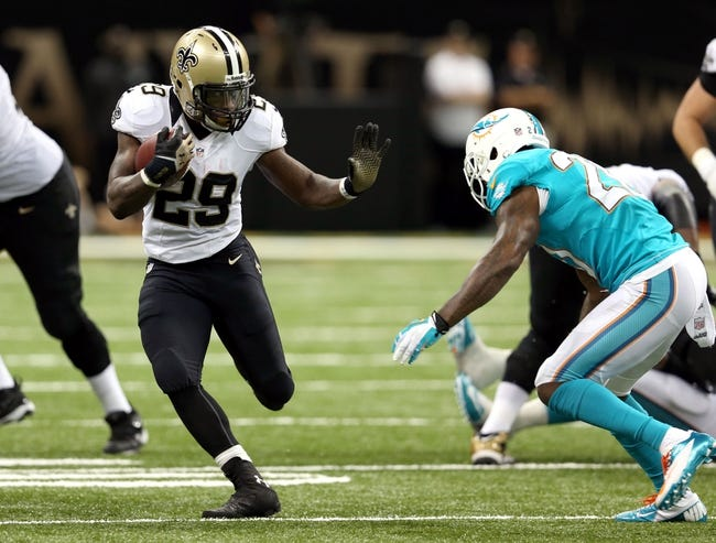 Sep 30, 2013; New Orleans, LA, USA; New Orleans Saints running back Khiry Robinson (29) runs against the Miami Dolphins during their game at the Mercedes-Benz Superdome. Mandatory Credit: Chuck Cook-USA TODAY Sports