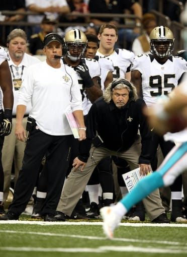 Sep 30, 2013; New Orleans, LA, USA; New Orleans Saints head coach Sean Payton and defensive coordinator Rob Ryan during the first quarter of their against the Miami Dolphins game at the Mercedes-Benz Superdome. Mandatory Credit: Chuck Cook-USA TODAY Sports