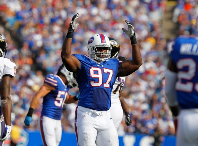 Sep 29, 2013; Orchard Park, NY, USA; Buffalo Bills defensive tackle Corbin Bryant (97) during a game against the Baltimore Ravens at Ralph Wilson Stadium. Bills beat Ravens 23 to 20.  Mandatory Credit: Timothy T. Ludwig-USA TODAY Sports