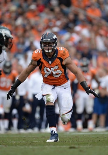 Sep 29, 2013; Denver, CO, USA; Denver Broncos defensive end Derek Wolfe (95) during the game against the Philadelphia Eagles at Sports Authority Field at Mile High. Mandatory Credit: Ron Chenoy-USA TODAY Sports