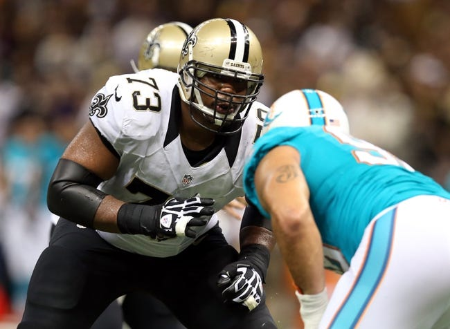 Sep 30, 2013; New Orleans, LA, USA; New Orleans Saints guard Jahri Evans (73) blocks during their game against the Miami Dolphins at the Mercedes-Benz Superdome. Mandatory Credit: Chuck Cook-USA TODAY Sports
