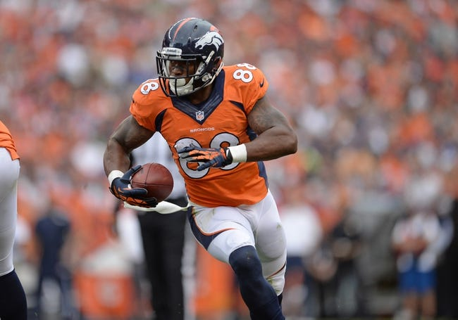 Sep 29, 2013; Denver, CO, USA; Denver Broncos wide receiver Demaryius Thomas (88) runs after a reception during the game against the Philadelphia Eagles at Sports Authority Field at Mile High. Mandatory Credit: Ron Chenoy-USA TODAY Sports