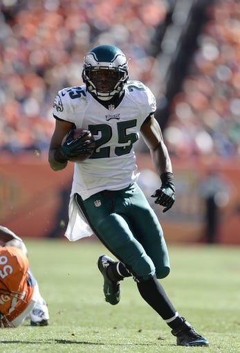 Sep 29, 2013; Denver, CO, USA; Philadelphia Eagles running back LeSean McCoy (25) runs with the football during the game against the Denver Broncos at Sports Authority Field at Mile High. Mandatory Credit: Ron Chenoy-USA TODAY Sports