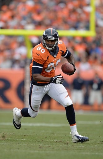 Sep 29, 2013; Denver, CO, USA; Denver Broncos tight end Julius Thomas (80) runs after a reception against the Philadelphia Eagles in the fourth quarter at Sports Authority Field at Mile High. Mandatory Credit: Ron Chenoy-USA TODAY Sports