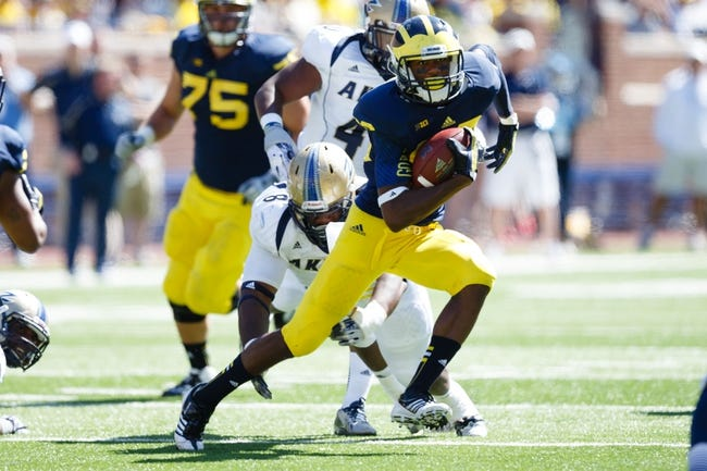 Sep 14, 2013; Ann Arbor, MI, USA; Michigan Wolverines tight end Jake Butt (88) runs the ball against the Akron Zips at Michigan Stadium. Mandatory Credit: Rick Osentoski-USA TODAY Sports