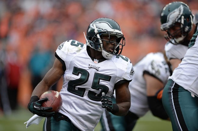 Sep 29, 2013; Denver, CO, USA; Philadelphia Eagles running back LeSean McCoy (25) rushes against the Denver Broncos in the fourth quarter at Sports Authority Field at Mile High. Mandatory Credit: Ron Chenoy-USA TODAY Sports