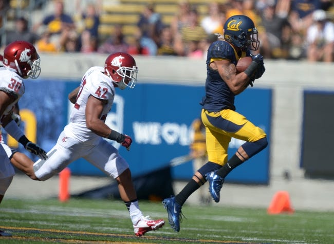 Oct 5, 2013; Berkeley, CA, USA; California Golden Bears receiver Chris Harper (5) is defended by Washington State Cougars safety Taylor Taliulu (30) and linebacker Cyrus Coen (42) at Memorial Stadium. Mandatory Credit: Kirby Lee-USA TODAY Sports