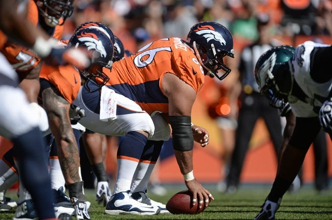 Sep 29, 2013; Denver, CO, USA; Denver Broncos center Manny Ramirez (66) prepares to hike the football against the Philadelphia Eagles in the first quarter at Sports Authority Field at Mile High. Mandatory Credit: Ron Chenoy-USA TODAY Sports