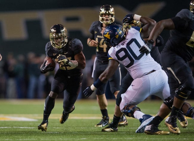 Oct 5, 2013; Waco, TX, USA; Baylor Bears running back Lache Seastrunk (25) runs with the ball against the West Virginia Mountaineers during the game at Floyd Casey Stadium. The Bears defeated the Mountaineers 73-42. Mandatory Credit: Jerome Miron-USA TODAY Sports