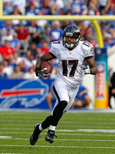 Sep 29, 2013; Orchard Park, NY, USA; Baltimore Ravens wide receiver Tandon Doss (17) runs the ball against the Buffalo Bills at Ralph Wilson Stadium. Bills beat Ravens 23 to 20.  Mandatory Credit: Timothy T. Ludwig-USA TODAY Sports
