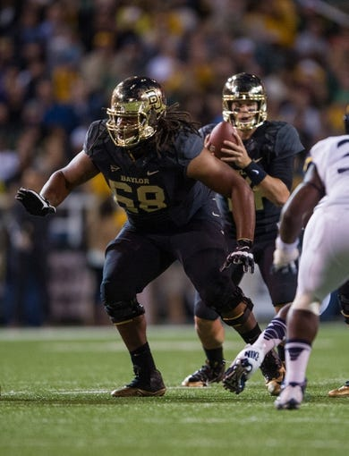 Oct 5, 2013; Waco, TX, USA; Baylor Bears guard Cyril Richardson (68) defends against the West Virginia Mountaineers attack during the game at Floyd Casey Stadium. The Bears defeated the Mountaineers 73-42. Mandatory Credit: Jerome Miron-USA TODAY Sports