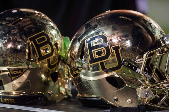Oct 5, 2013; Waco, TX, USA; A view of the new chrome Baylor Bears helmets during the game between the Bears and the West Virginia Mountaineers at Floyd Casey Stadium. The Bears defeated the Mountaineers 73-42. Mandatory Credit: Jerome Miron-USA TODAY Sports