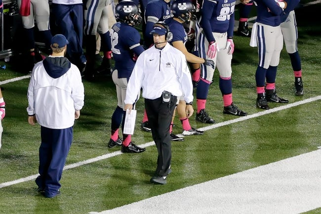 Oct 4, 2013; Logan, UT, USA; Utah State Aggies head coach Matt Wells walks the sideline during the fourth quarter at Romney Stadium.  Brigham Young Cougars defeated the Utah State Aggies 31-14.  Mandatory Credit: Chris Nicoll-USA TODAY Sports