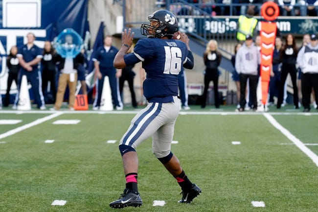 Oct 4, 2013; Logan, UT, USA; Utah State Aggies quarterback Chuckie Keeton (16) looks downfield during the game against Brigham Young Cougars at Romney Stadium.  Brigham Young Cougars defeated the Utah State Aggies 31-14.  Mandatory Credit: Chris Nicoll-USA TODAY Sports