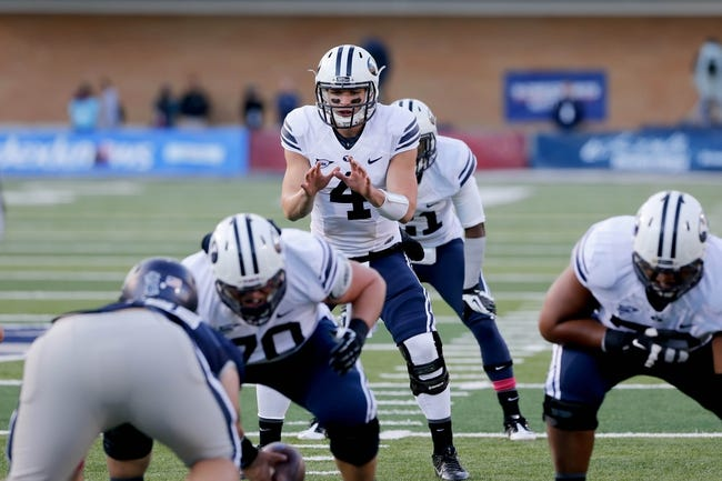 Oct 4, 2013; Logan, UT, USA; Brigham Young Cougars quarterback Taysom Hill (4) takes the snap during the game against the Utah State Aggies at Romney Stadium.  Brigham Young Cougars defeated the Utah State Aggies 31-14.  Mandatory Credit: Chris Nicoll-USA TODAY Sports