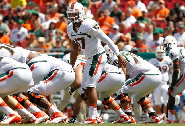 Sep 28, 2013; Tampa, FL, USA; Miami Hurricanes quarterback Stephen Morris (17) calls a play against the South Florida Bulls during the first half at Raymond James Stadium. Mandatory Credit: Kim Klement-USA TODAY Sports