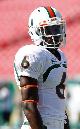 Sep 28, 2013; Tampa, FL, USA; Miami Hurricanes wide receiver Herb Waters (6) against the South Florida Bulls at Raymond James Stadium. Mandatory Credit: Kim Klement-USA TODAY Sports