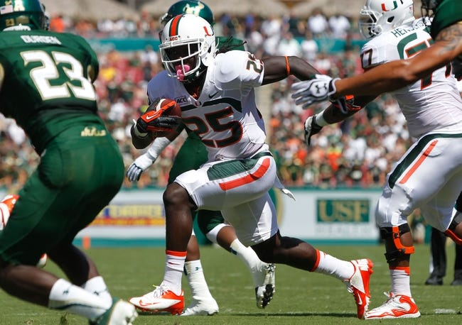 Sep 28, 2013; Tampa, FL, USA; Miami Hurricanes running back Dallas Crawford (25) runs with the ball against the South Florida Bulls during the first quarter at Raymond James Stadium. Mandatory Credit: Kim Klement-USA TODAY Sports