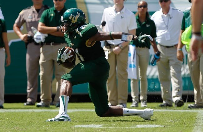 Sep 28, 2013; Tampa, FL, USA; South Florida Bulls wide receiver Andre Davis (81) runs against the Miami Hurricanes during the second half at Raymond James Stadium. Miami Hurricanes defeated the South Florida Bulls 49-21. Mandatory Credit: Kim Klement-USA TODAY Sports