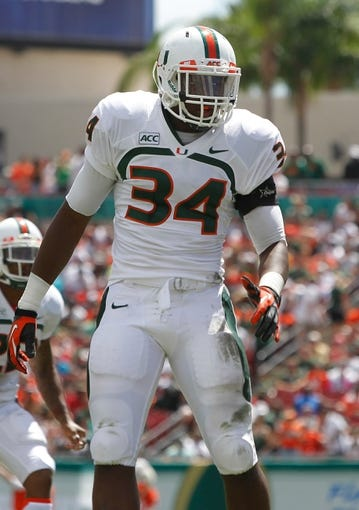 Sep 28, 2013; Tampa, FL, USA; Miami Hurricanes linebacker Thurston Armbrister (34) against the South Florida Bulls during the first half at Raymond James Stadium. Mandatory Credit: Kim Klement-USA TODAY Sports
