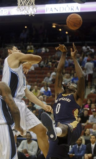 Oct 9, 2013; Jacksonville, FL, USA; Orlando Magic center Nikola Vucevic (9) rejects a shot by New Orleans Pelicans forward Al-Farouq Aminu (0) in the first quarter of their game at Jacksonville Veterans Memorial Arena. Mandatory Credit: Phil Sears-USA TODAY Sports