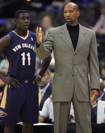 Oct 9, 2013; Jacksonville, FL, USA; New Orleans Pelicans guard Jrue Holiday (11) listens to head coach Monty Williams in the first quarter of their game against the Orlando Magic at Jacksonville Veterans Memorial Arena. Mandatory Credit: Phil Sears-USA TODAY Sports