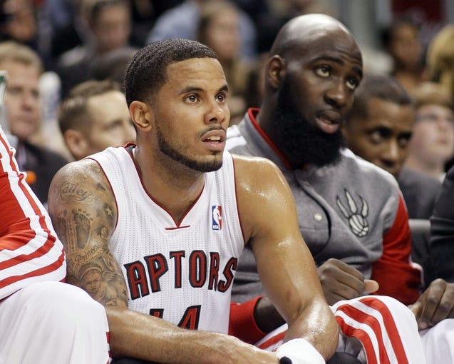 Oct 9, 2013; Toronto, Ontario, CAN; Toronto Raptors guard D.J. Augustin (14) and forward Quincy Acy (right) on the bench against the Minnesota Timberwolves during the first half at the Air Canada Centre. Mandatory Credit: John E. Sokolowski-USA TODAY Sports