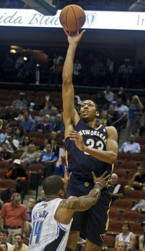 Oct 9, 2013; Jacksonville, FL, USA; New Orleans Pelicans forward/center Anthony Davis (23) shoots the ball over Orlando Magic guard Jameer Nelson (14) in the first quarter of their game at Jacksonville Veterans Memorial Arena. Mandatory Credit: Phil Sears-USA TODAY Sports