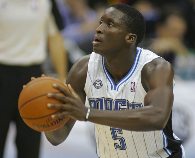 Oct 9, 2013; Jacksonville, FL, USA; Orlando Magic guard Victor Oladipo (5) shoots a free throw in the first quarter of their game against the New Orleans Pelicans at Jacksonville Veterans Memorial Arena. Mandatory Credit: Phil Sears-USA TODAY Sports