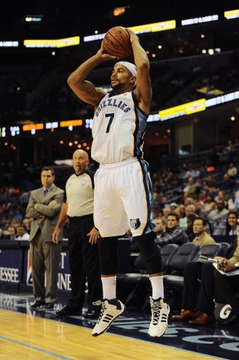 Oct 9, 2013; Memphis, TN, USA; Memphis Grizzlies point guard Jerryd Bayless (7) takes a jump shot against Dallas Mavericks at FedExForum. Mandatory Credit: Justin Ford-USA TODAY Sports