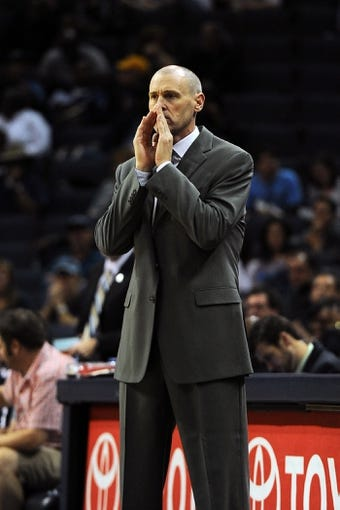 Oct 9, 2013; Memphis, TN, USA; Dallas Mavericks head coach Rick Carlisle calls a play during the game against the Memphis Grizzlies at FedExForum. Mandatory Credit: Justin Ford-USA TODAY Sports