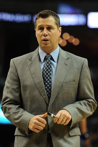 Oct 9, 2013; Memphis, TN, USA; Memphis Grizzlies head coach Dave Joerger calls a timeout against Dallas Mavericks at FedExForum. Mandatory Credit: Justin Ford-USA TODAY Sports