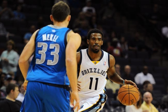 Oct 9, 2013; Memphis, TN, USA; Memphis Grizzlies point guard Mike Conley (11) handles the ball against Dallas Mavericks point guard Gal Mekel (33) in the second quarter  at FedExForum. Mandatory Credit: Justin Ford-USA TODAY Sports