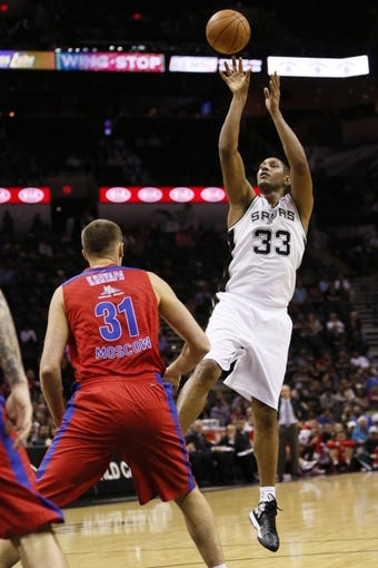 Oct 9, 2013; San Antonio, TX, USA; San Antonio Spurs forward Boris Diaw (33) takes a shot over CSKA Moscow forward Viktor Khryapa (31) during the first half at the AT&T Center. Mandatory Credit: Soobum Im-USA TODAY Sports