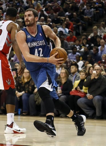 Oct 9, 2013; Toronto, Ontario, CAN; Minnesota Timberwolves forward-center Kevin Love (42) carries the ball to the net against the Toronto Raptors at the Air Canada Centre. Minnesota defeated Toronto 101-89. Mandatory Credit: John E. Sokolowski-USA TODAY Sports