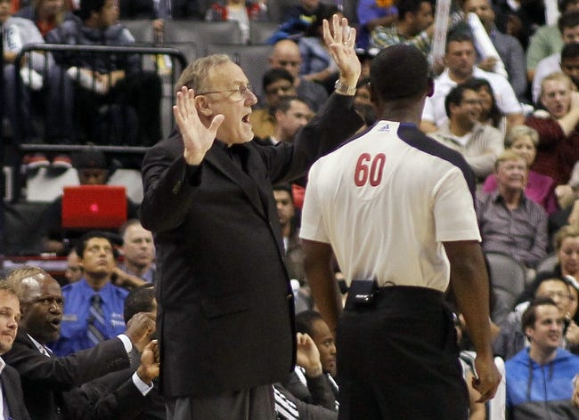 Oct 9, 2013; Toronto, Ontario, CAN; Minnesota Timberwolves head coach Rick Adelman questions a call by official James Williams (60) during a game against the Toronto Raptors at the Air Canada Centre. Minnesota defeated Toronto 101-89. Mandatory Credit: John E. Sokolowski-USA TODAY Sports