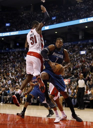 Oct 9, 2013; Toronto, Ontario, CAN; Minnesota Timberwolves forward Derrick Williams (7) comes down with the ball as Toronto Raptors guard Terrence Ross (31) defends at the Air Canada Centre. Minnesota defeated Toronto 101-89. Mandatory Credit: John E. Sokolowski-USA TODAY Sports