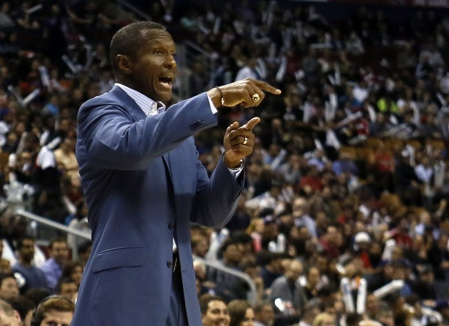 Oct 9, 2013; Toronto, Ontario, CAN; Toronto Raptors head coach Dwane Casey talks to a player during a break in the action against the Minnesota Timberwolves at the Air Canada Centre. Minnesota defeated Toronto 101-89. Mandatory Credit: John E. Sokolowski-USA TODAY Sports