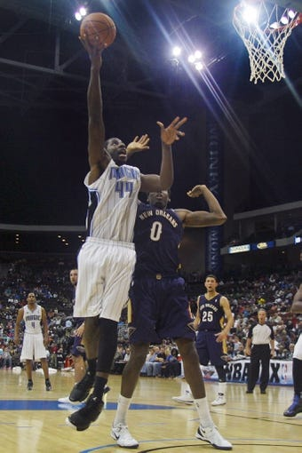 Oct 9, 2013; Jacksonville, FL, USA; Orlando Magic forward Andrew Nicholson (44) shoots the ball defended by New Orleans Pelicans forward Al-Farouq Aminu (0) in the second half of their game at Jacksonville Veterans Memorial Arena. The New Orleans Pelicans beat the Orlando Magic 99-95. Mandatory Credit: Phil Sears-USA TODAY Sports